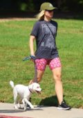 Kristen Bell wears patterned workout shorts as she takes her white pooch on a walk through Griffith Park in Los Angeles