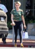 Kristen Stewart rocks a camo crop top and Adidas leggings while she runs a few errands before stopping for gas in Los Angeles