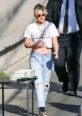 Kristen Stewart rocks a midriff baring cropped t-shirt as she arrives at Jimmy Kimmel Live! in Hollywood, California