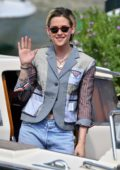 Kristen Stewart waves for the camera as she steps out during 76th Venice Film Festival in Venice, Italy
