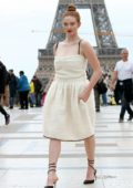 Larsen Thompson poses in front of the Eiffel Tower after Rochas SS20 during Paris Fashion Week in Paris, France