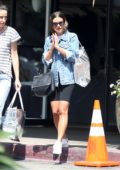 Lea Michele wears a denim jacket with white tee and black biker shorts while out with friend in out in Los Angeles