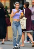 Lily-Rose Depp flashes her toned midriff while out wearing headphones in New York City