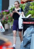 Lily-Rose Depp wears a black top and purple biker shorts with Adidas slides while out and about in New York City