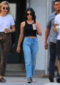 Lucy Hale rocks a cropped tank top and jeans while out for an iced coffee with friends in Manhattan, New York City