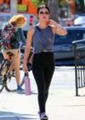 Lucy Hale sports a grey top and black leggings as she heads to the gym in Studio City, Los Angeles