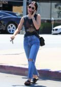 Lucy Hale spotted chatting on her phone as she leaves a clinic with a band-aid on her arm in Los Angeles