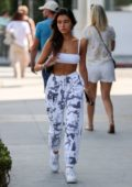 Madison Beer rocks a white sports bra with camo sweatpants while out shopping in Beverly Hills, Los Angeles