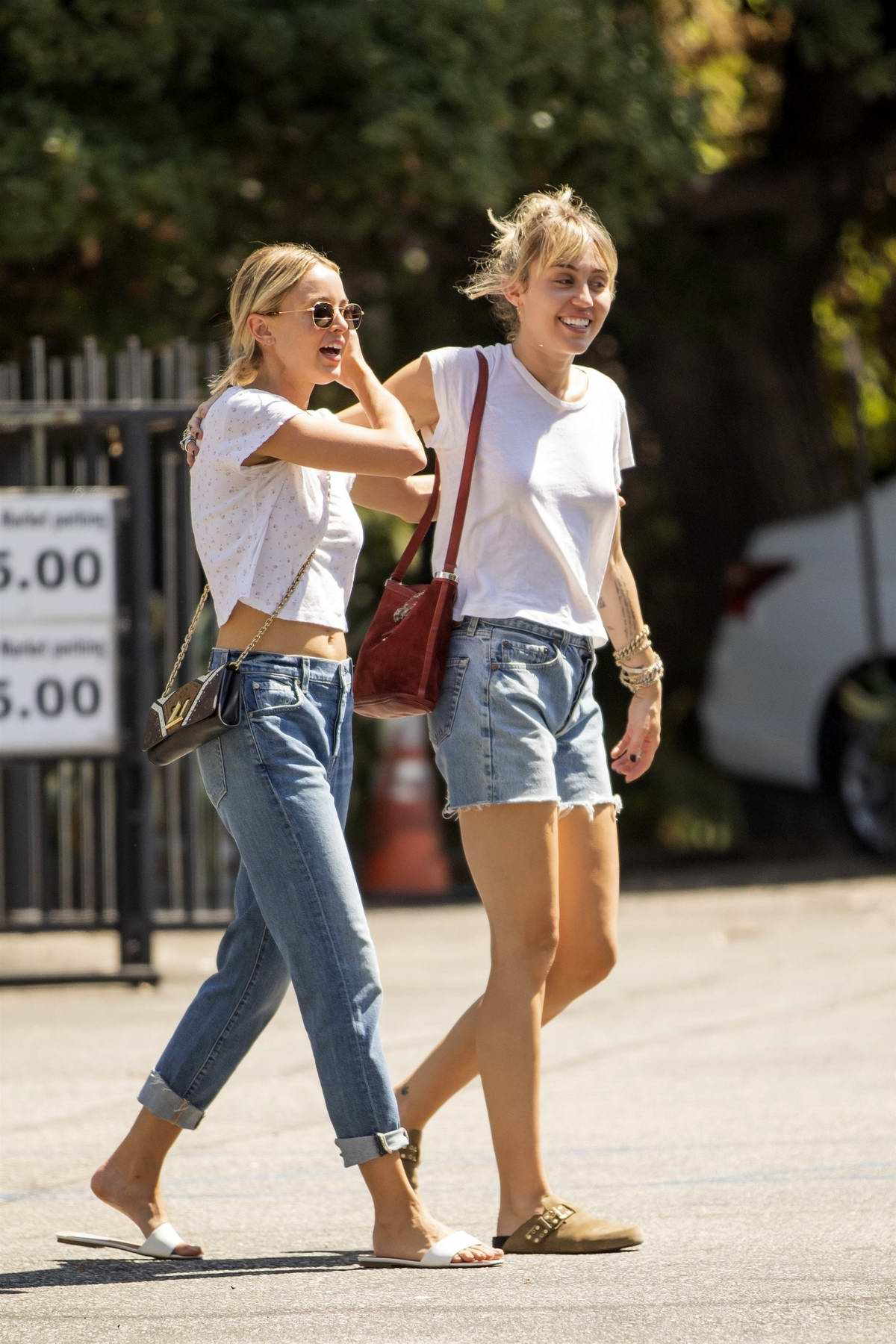 Miley Cyrus and Kaitlynn Carter are all smiles as they grab lunch in Los Angeles