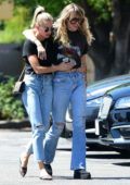 Miley Cyrus and Kaitlynn Carter step out in matching outfits for a walk together in Los Angeles