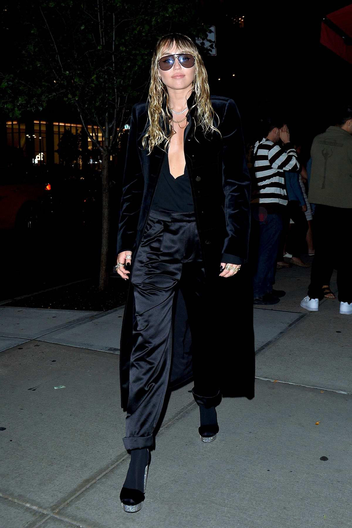 Miley Cyrus dons all-black as she steps out of the Tom Ford Fashion Show during NYFW in New York City