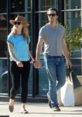 Natalie Dormer and David Oakes hold hands while shopping on Melrose Place in West Hollywood, Los Angeles