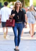 Nicky Hilton keeps it chic in a black shirt and jeans with a red Dior bag while out in New York City