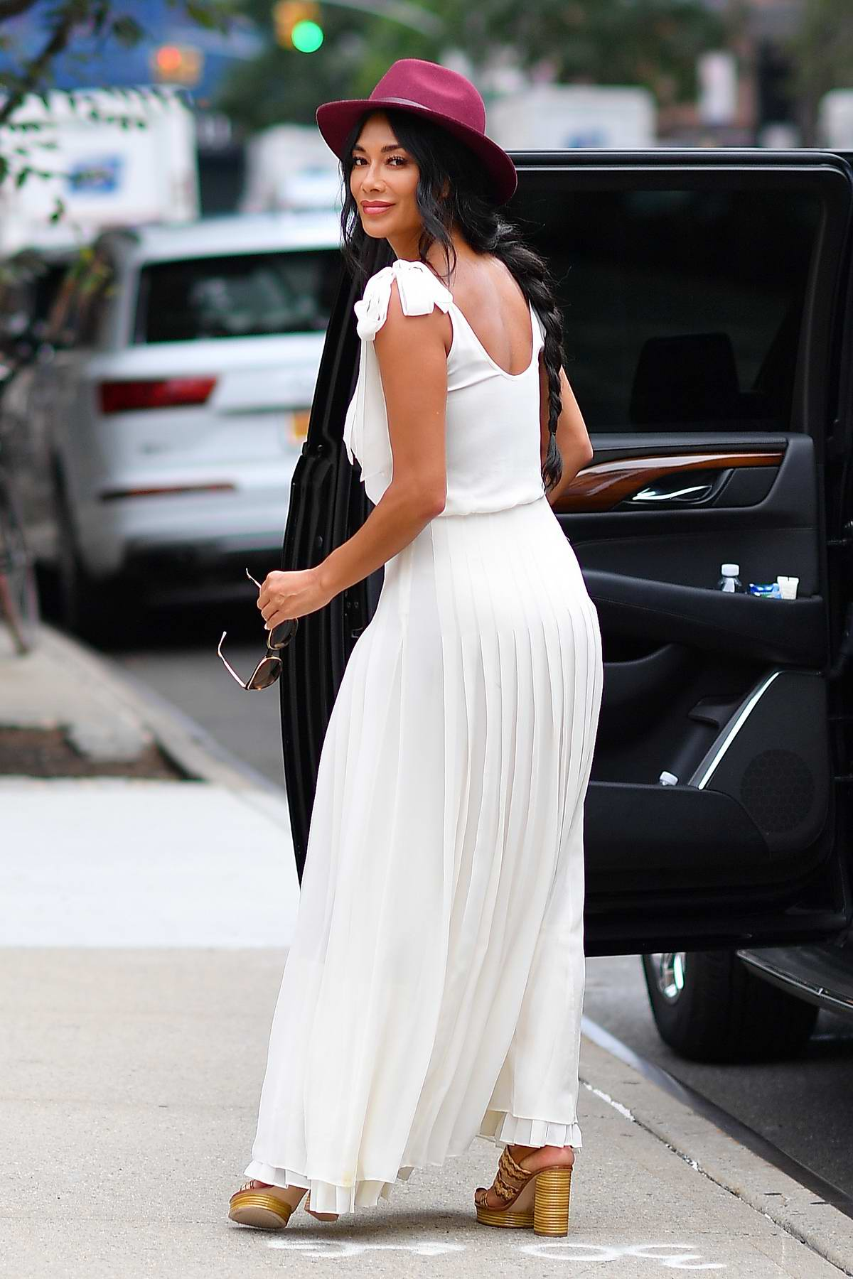 Nicole Scherzinger looks great in a white dress with maroon fedora while out in New York City