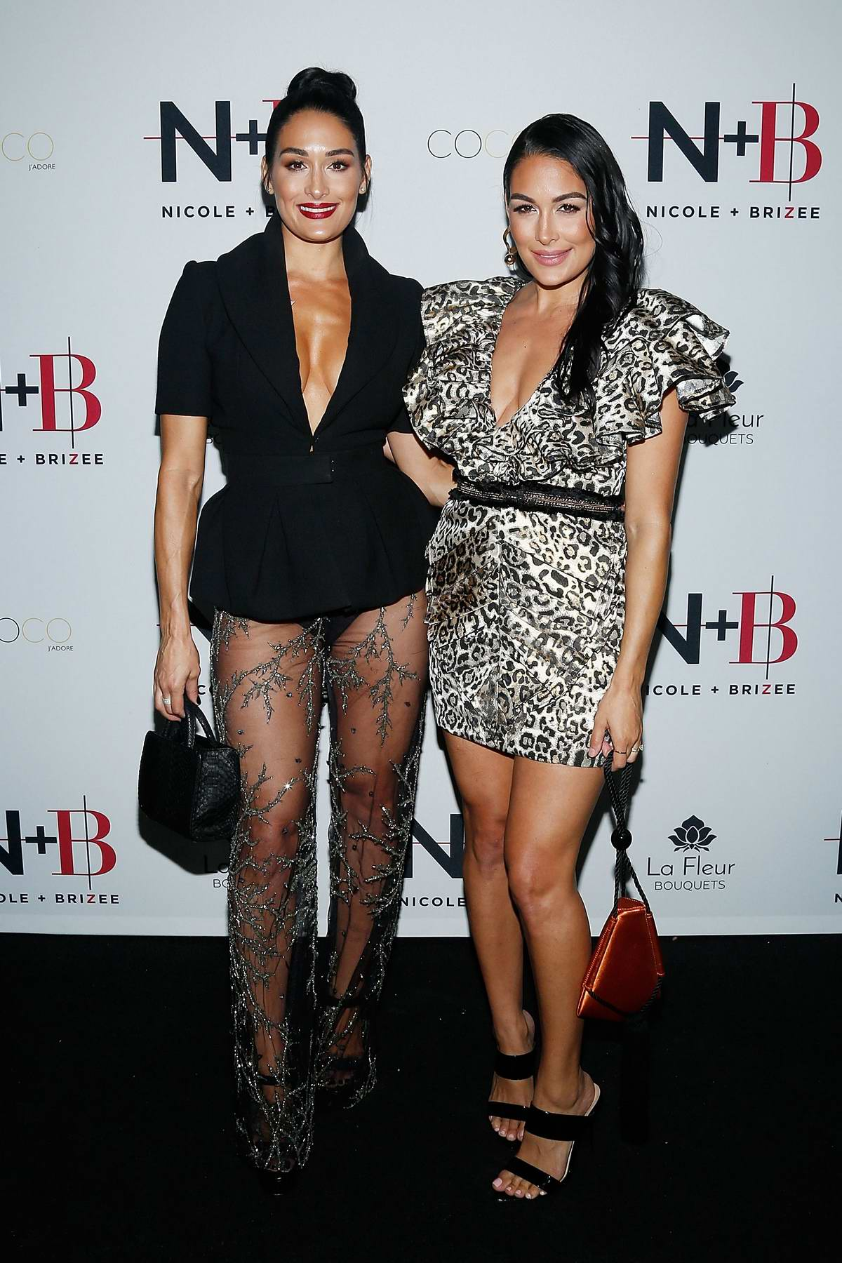 Nikki and Brie Bella attend the launch of their new product line during New York Fashion Week in New York City