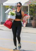 Nikki Bella is all smiles as she leaves a flower shop with roses and floral arrangements in Los Angeles