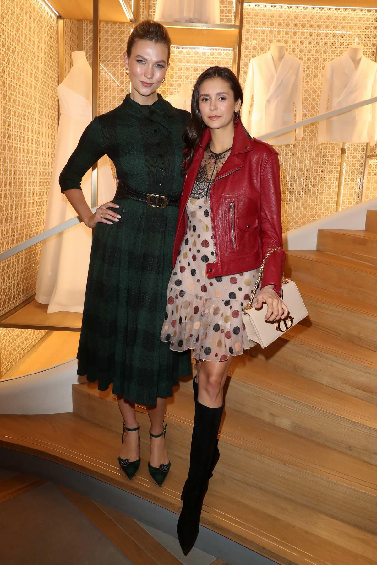 Nina Dobrev and Karlie Kloss at the Dior Champs-Elysees Flagship Inauguration in Paris, France
