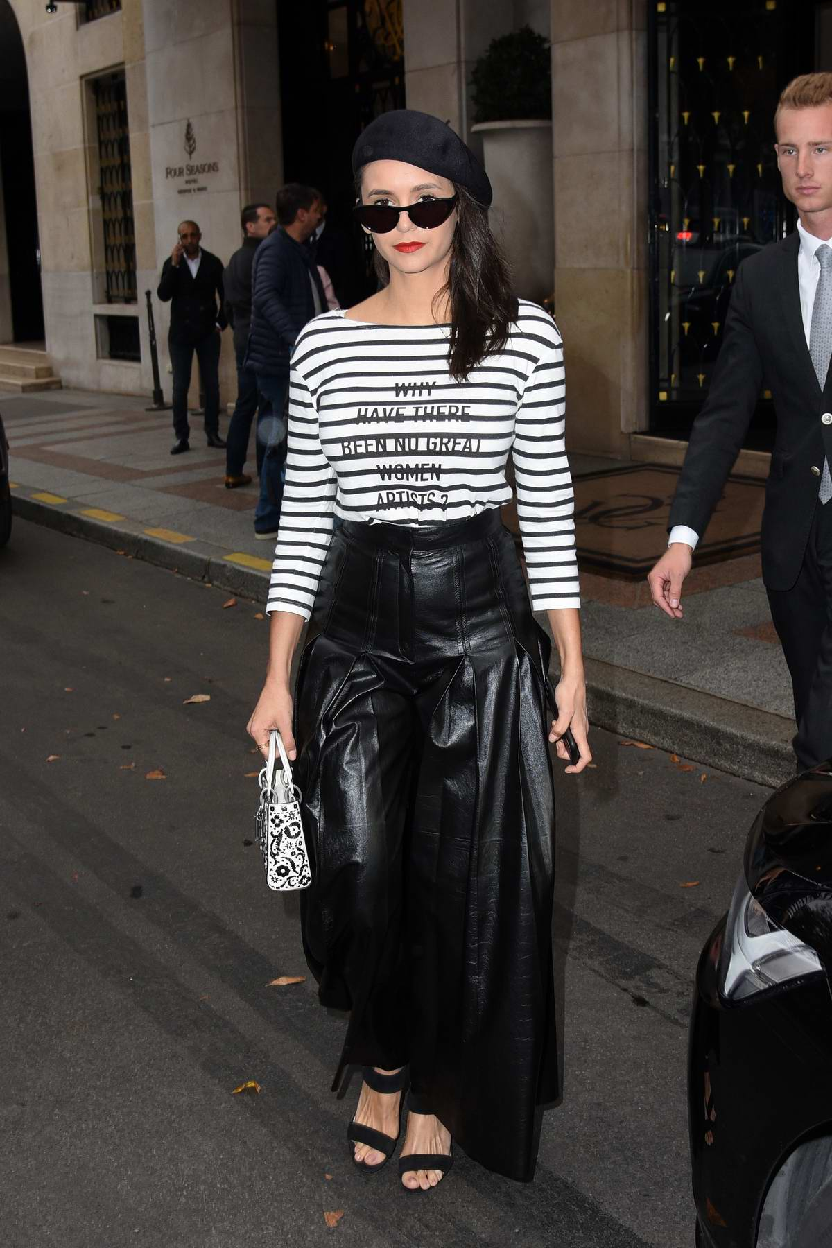 Nina Dobrev looks stylish in black leather skirt as she leaves the George V Hotel in Paris, France