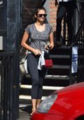 Nina Dobrev seen wearing black leggings and a grey top as she leaves the gym in West Hollywood, Los Angeles