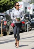 Nina Dobrev sports a light grey hoodie and dark grey leggings as she grabs a healthy salad in West Hollywood, Los Angeles