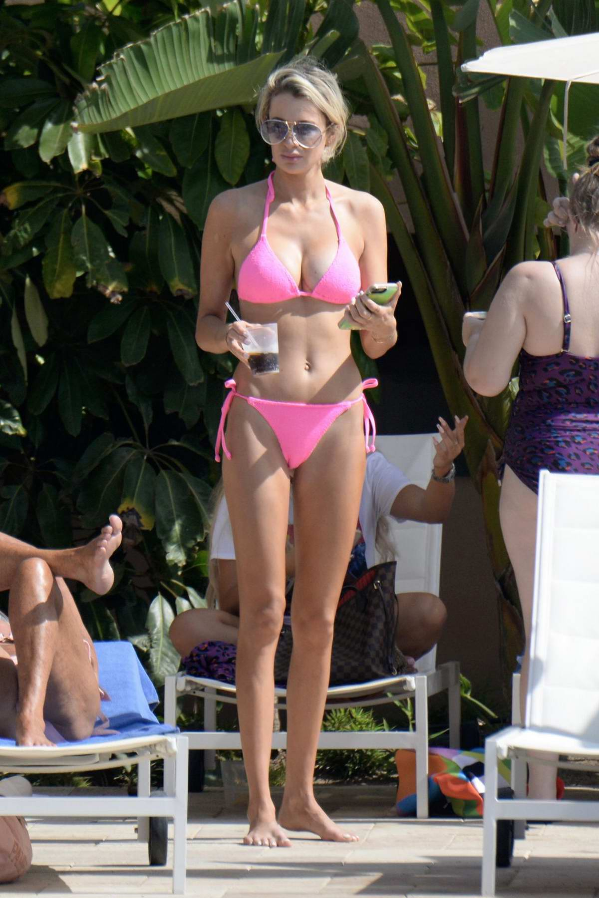 Olivia Attwood wears a pink bikini as she hits the pool in Marbella, Spain