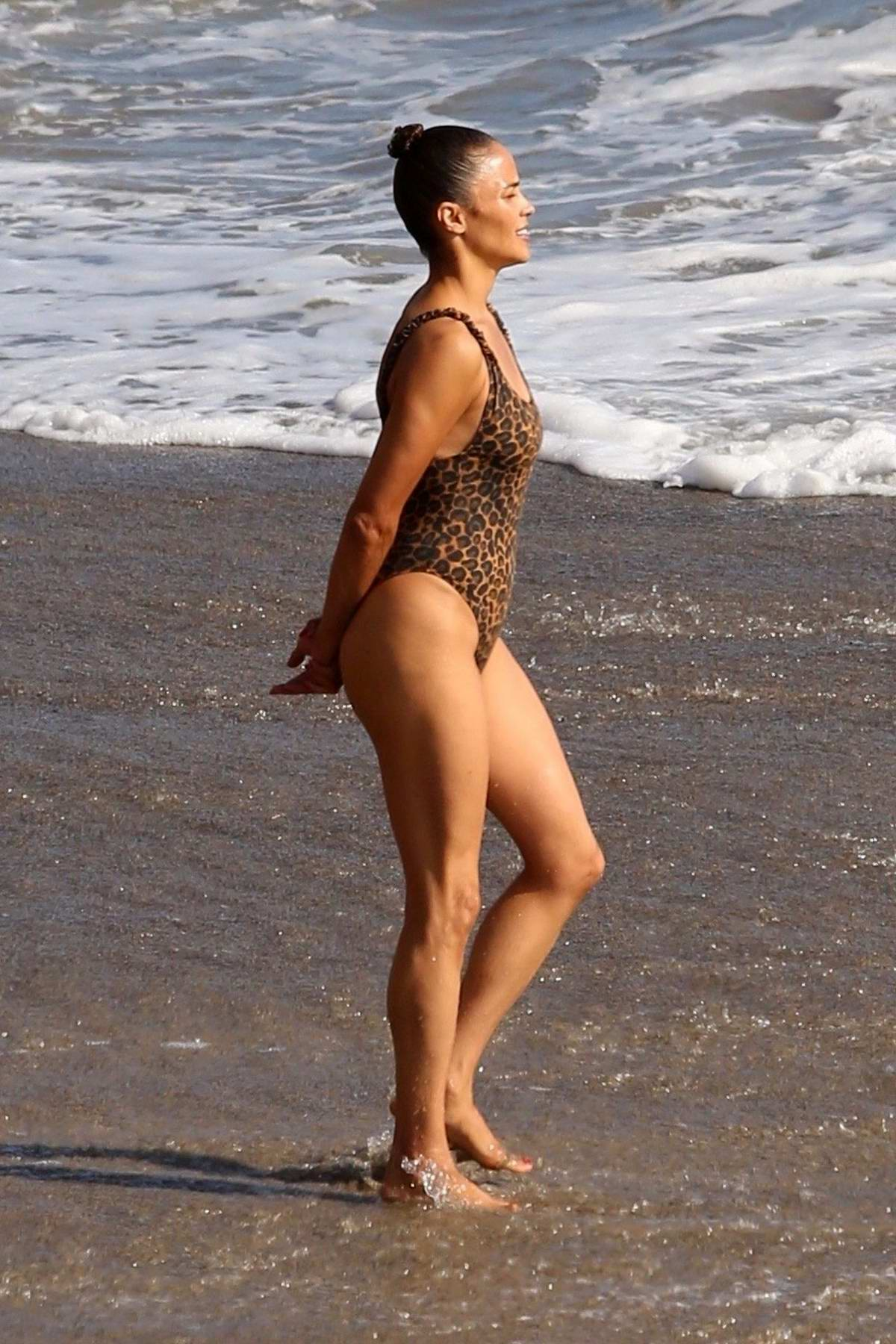 paula patton wears a leopard print swimsuit as she hits