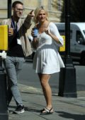 Pixie Lott spotted in a short white dress while filming on the streets of London, UK