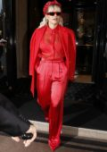Rita Ora dazzles in an all red ensemble as she leaves her hotel during Paris Fashion Week in Paris, France