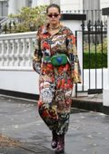 Rita Ora seen wearing a colorful grungy jumpsuit as she steps out in London, UK