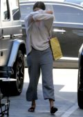 Selena Gomez covers her face on her way to Nine Zero hair salon in West Hollywood, Los Angeles
