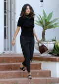 Selena Gomez looks great in all black ensemble as she stops by a friends house in Los Angeles