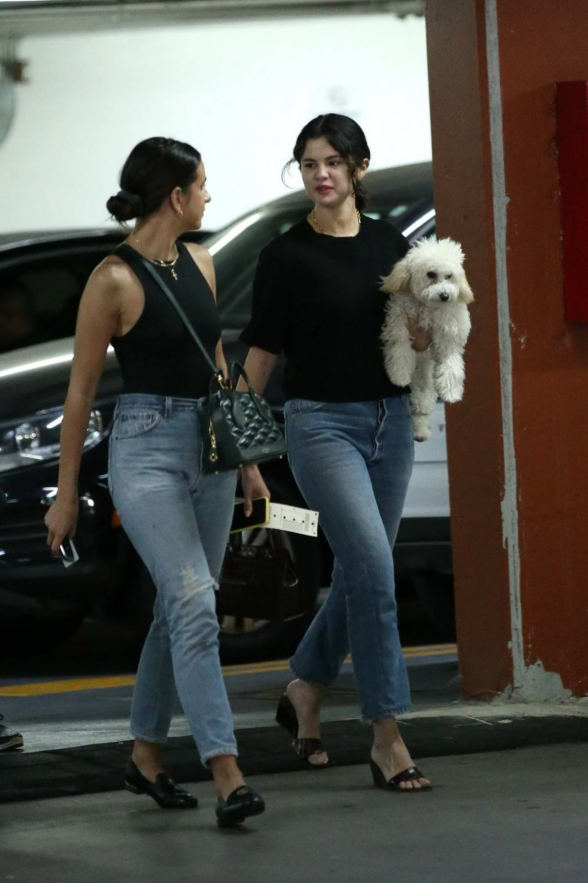 Selena Gomez seen leaving a 'Shark Tank' filming studio with her puppy in West Hollywood, Los Angeles
