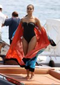 Shanina Shaik dons a black swimsuit while posing on a boat during a photoshoot in Mykonos, Greece