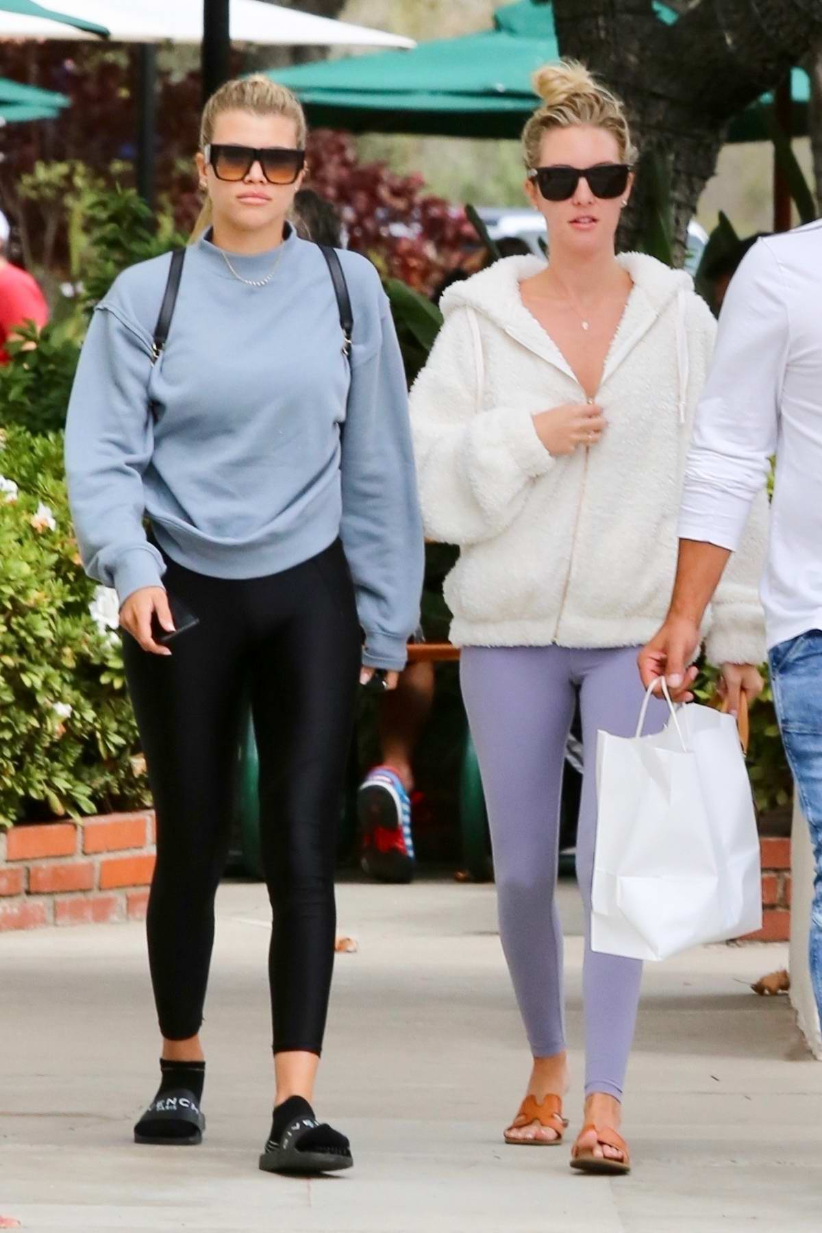 Sofia Richie keeps it casual with a grey sweatshirt and black leggings while out for lunch with friends in Malibu, California