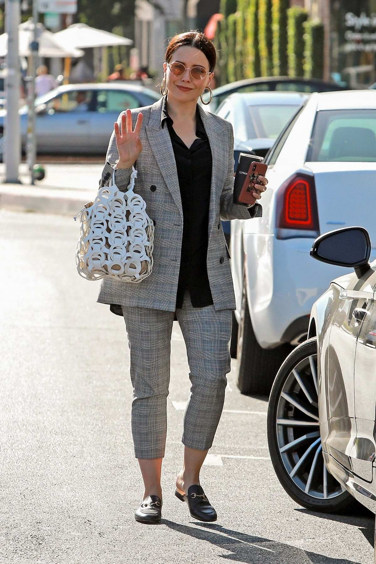 Sophia Bush wears a grey checkered suit during a shopping trip on Melrose Place in West Hollywood, Los Angeles