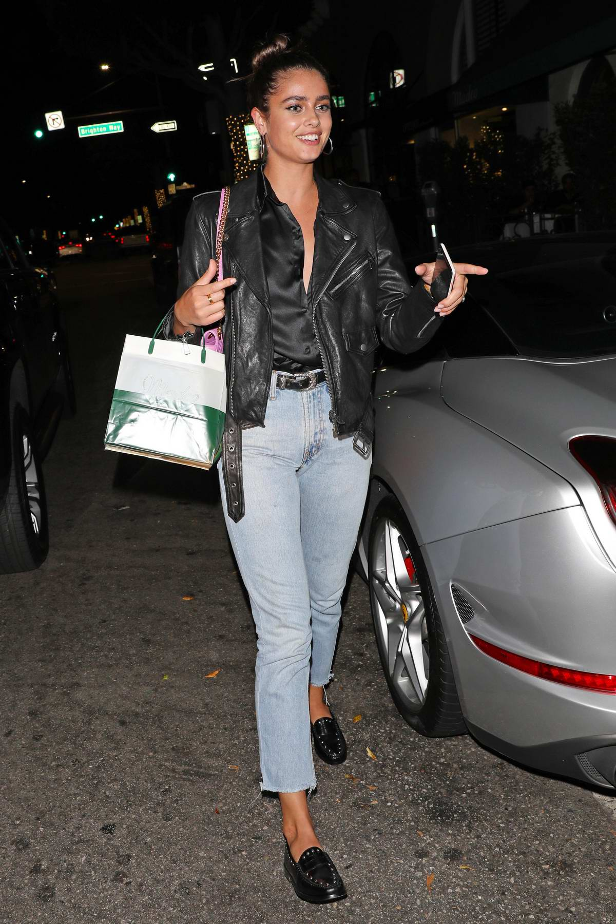 Taylor Hill is all smiles as she leaves after dinner at Madeo in Beverly Hills, Los Angeles
