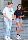 Thylane Blondeau wears a cropped black tee and denim shorts while out shopping with boyfriend Milane Meritte at Maxfield in Los Angeles