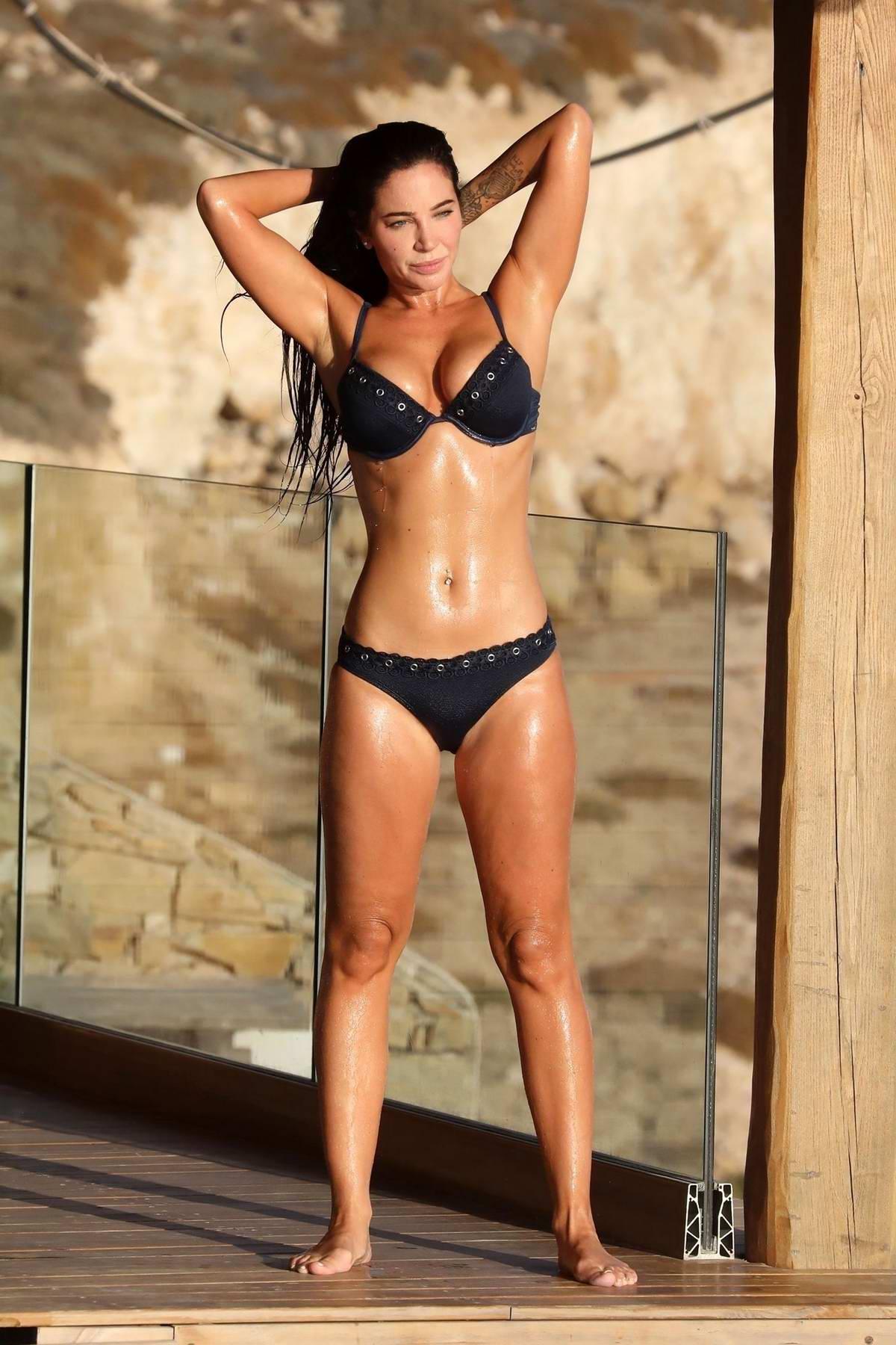 Tulisa Contostavlos wears a blue bikini while enjoying her holiday break in Greece
