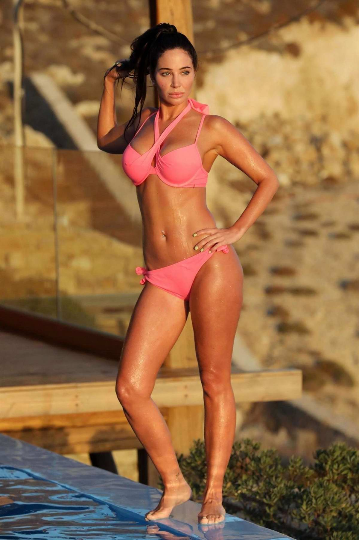 Tulisa Contostavlos wears a pink bikini while enjoying the pool with friends in Greece