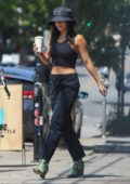Vanessa Hudgens wears a bucket hat with a crop top and jeans while out on a coffee run in Los Feliz, California