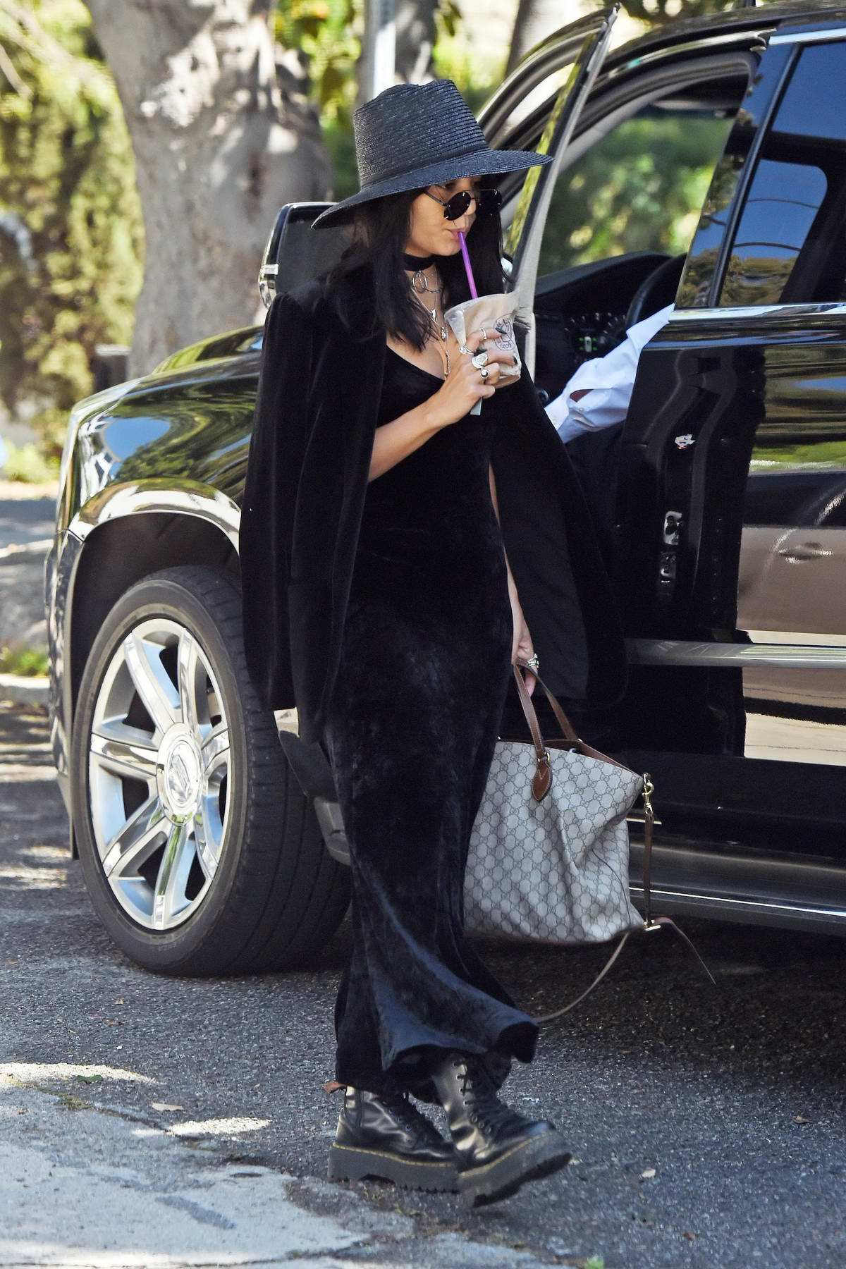 Vanessa Hudgens wore an all black ensemble with a matching hat and boots while out for coffee in Los Angeles