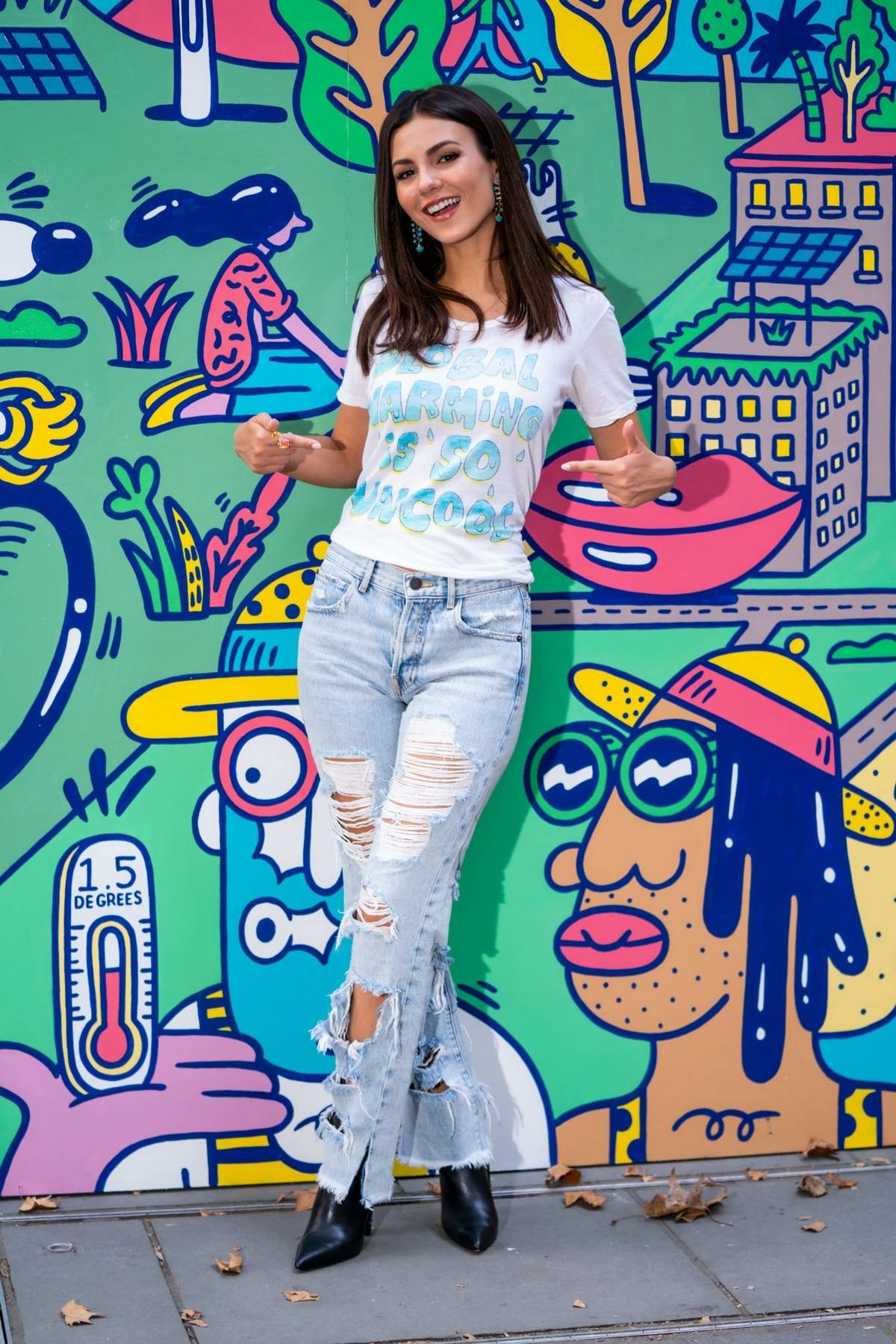 Victoria Justice visits the 'Pledge For Planet' mural at Bryant Park in New York City