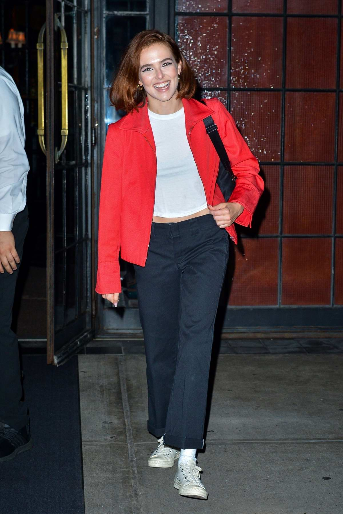 Zoey Deutch is all smiles as she exits The Bowery Hotel wearing red jacket in New York City