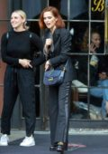 Zoey Deutch shows off her style in a tuxedo suit with polka dotted top in New York City