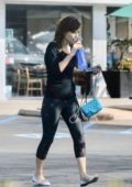 Zooey Deschanel heads to the gym wearing a black top and patterned leggings in Los Angeles