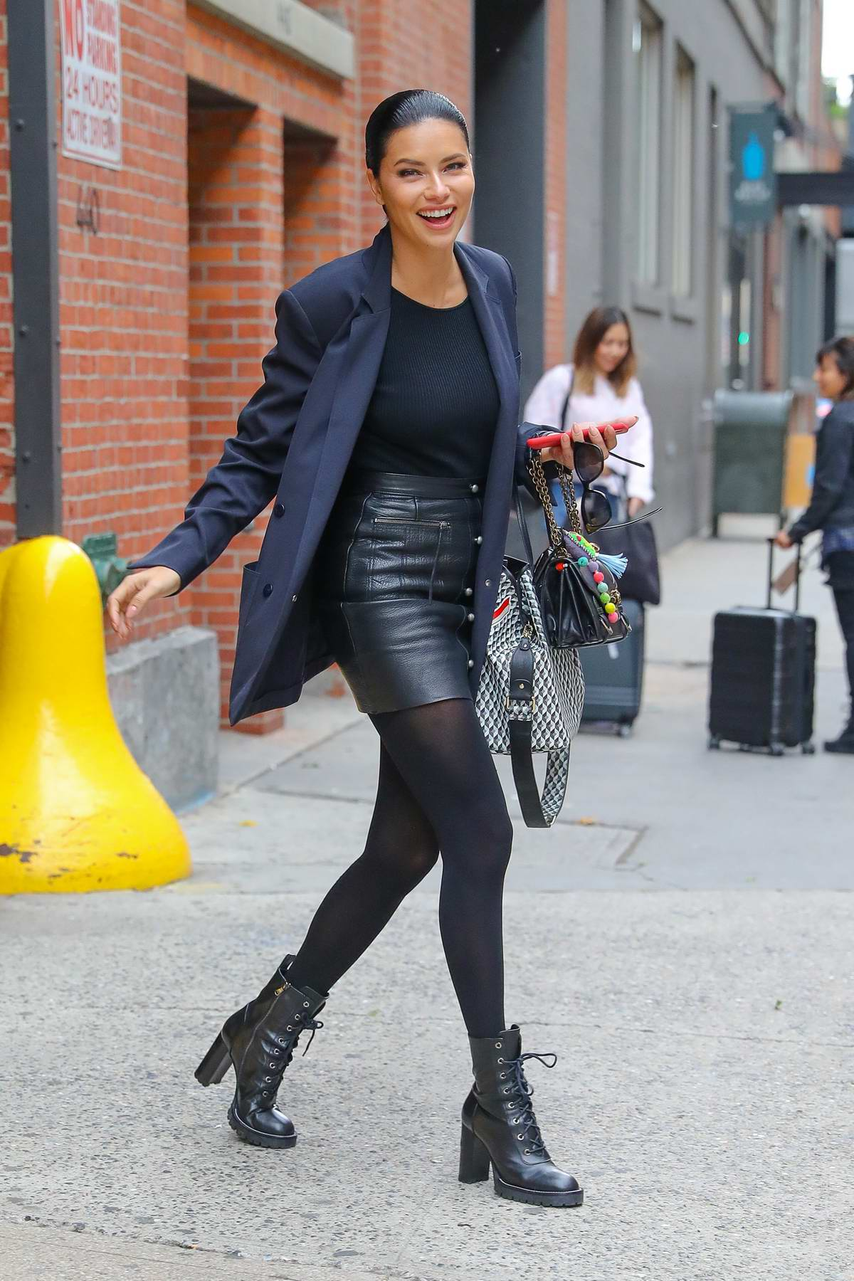 Adriana Lima is all smiles as she leaves after a photoshoot in New York City