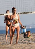 Alessandra Ambrosio looks fab in a light pink bikini while playing volleyball with friends during a beach day in Santa Monica, California