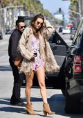 Alessandra Ambrosio looks stylish in a pink romper with a beige cardigan and brown ankle boots while out for lunch in Santa Monica, California