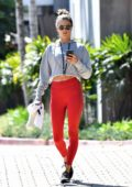 Alessandra Ambrosio rocks cropped grey hoodie and red leggings as she attends a yoga class in Malibu, California