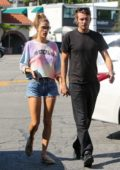 Alessandra Ambrosio wears a colorful tie-die sweatshirt and denim shorts for an outing with Nicolo Oddi in Los Angeles